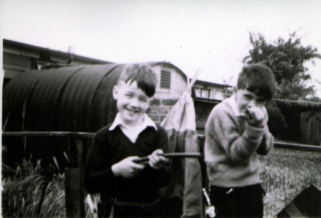 John and friend in prefab garden, Underhill Road, London SE22 | John Chinery