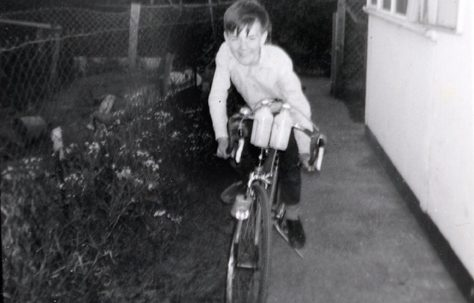 John on his bike by the prefab in Underhill Road, London SE22
