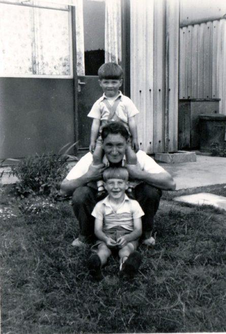 Man with two small boys in prefab garden. Kedleston Gardens, Hainault