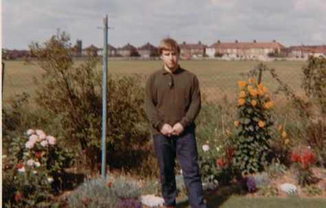 Richard in his prefab back garden overlooking the playing fields. Kedleston Gardens, Hainault