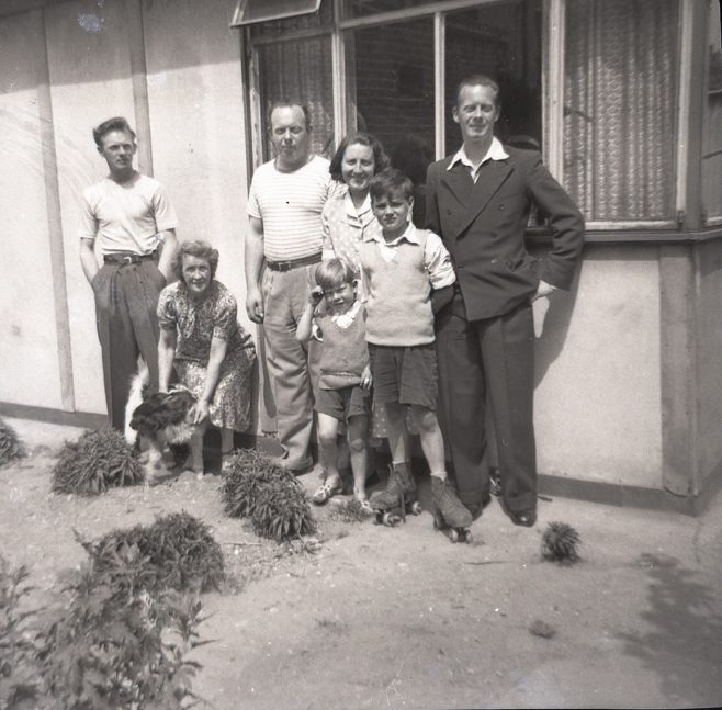 Catherine's cousins, her Nan, and her aunt and uncles outside their prefab in Carol Street, Camden Town. | Catherine Bazell