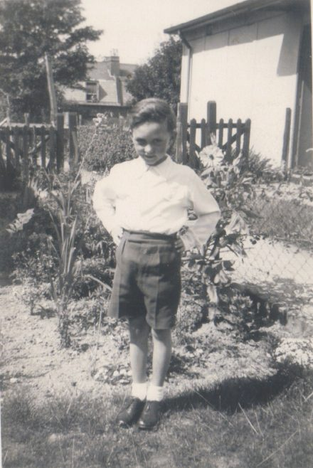 Terence standing by the flowerbed in his prefab garden, Dartmouth Park Hill, London N19