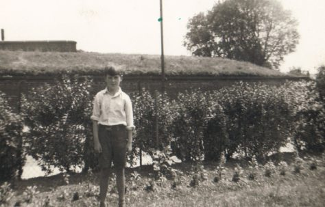 Terence standing by the hedge in his prefab garden, Dartmouth Park Hill, London N19