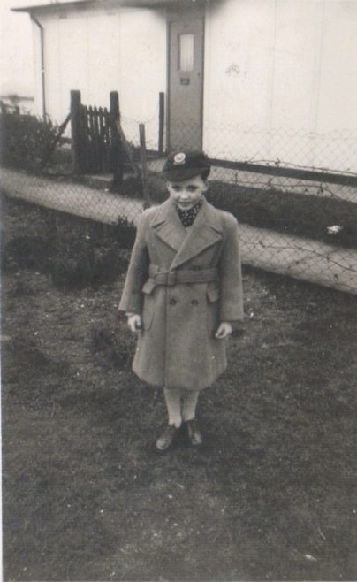April 1956. Terence in his first Crombie overcoat in front of the prefab, Dartmouth Park Hill, London NW5