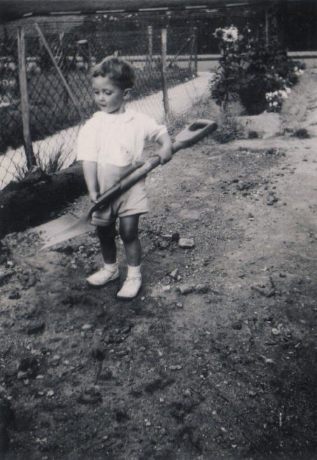 Terence with a large shovel in the prefab garden, Dartmouth Park Hill, London N19
