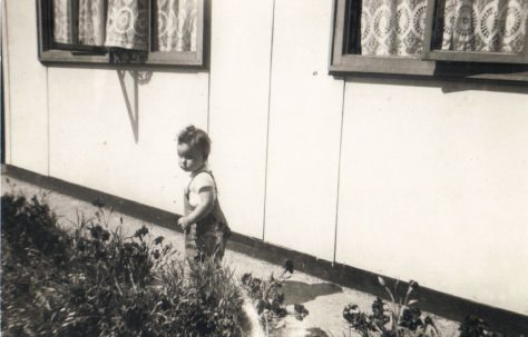 Terence's cousin Denise outside his prefab, Dartmouth Park Hill, London NW5