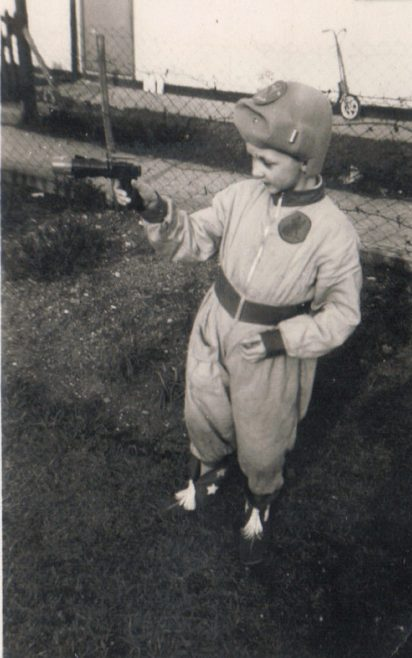 Terence dressed as a spaceman outside his prefab, Dartmouth Park Hill, London N19