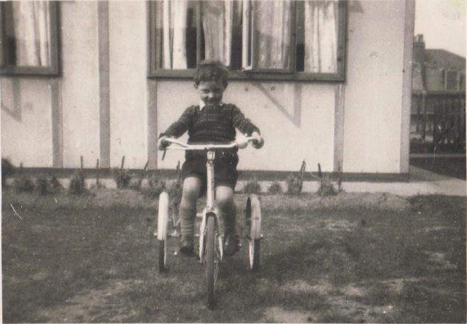 Terence on his tricycle outside the prefab, Dartmouth Park Hill, London N19