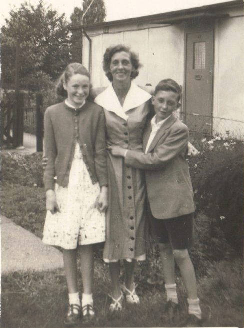 Terence, his mother and cousin Patricia from Blyth Northumberland, outside the prefab, Dartmouth Park Hill, London NW5