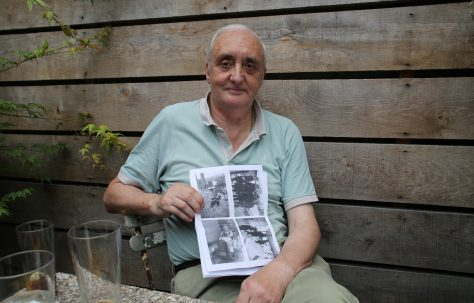 Portrait of Terence Flanagan with his photos