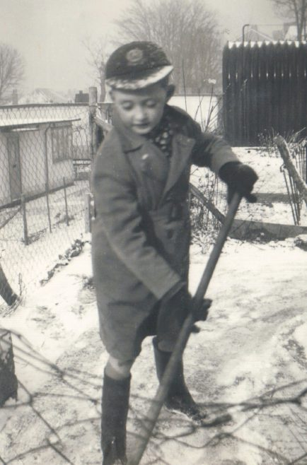 Terence shovelling snow outside his prefab in Dartmouth Park Hill, London N19