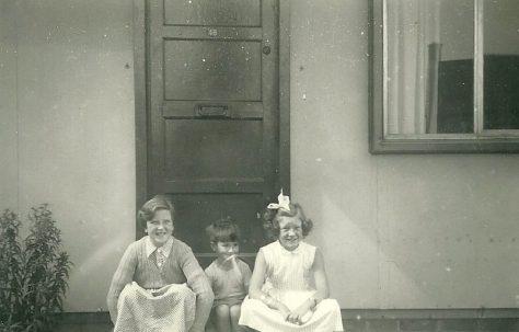 Mel, Peter and Hilary Ball  on the step of their prefab, 48 Abbots Gardens, Shrewsbury
