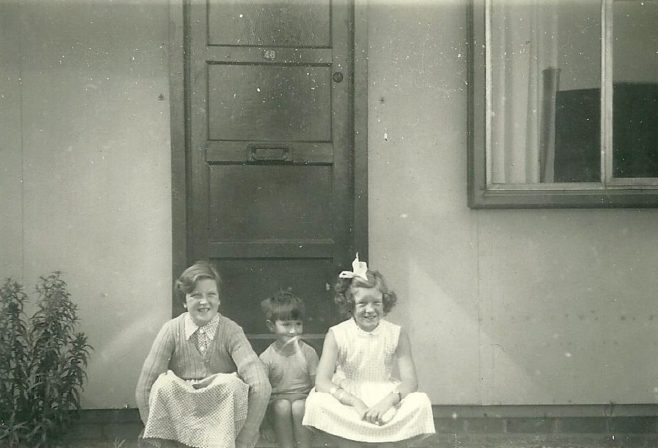 Mel, Peter and Hilary Ball  on the step of their prefab, 48 Abbots Gardens, Shrewsbury   Peter Ford