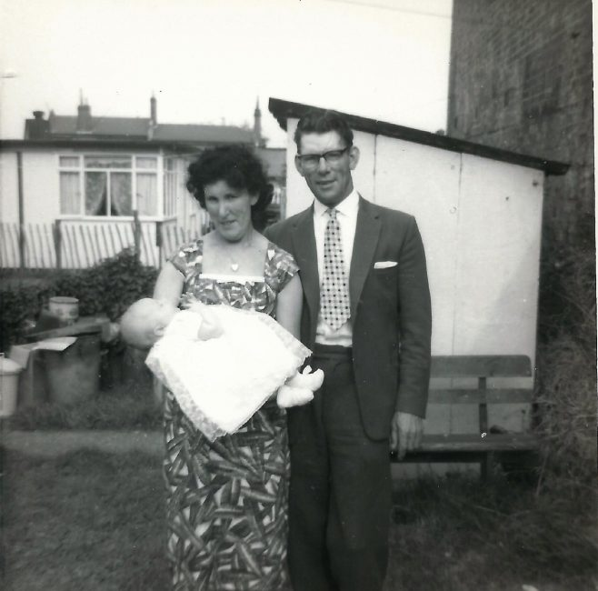 Kit and Charlie Phelps (Paul'spaternalgrandmother and her second husband) holding their first grandchild (Gary Maslin - Paul's cousin). Berthon Street, Deptford, London SE8