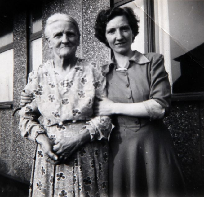 Mum with her grandmother outside Tarran prefab. Bolsover, Derbyshire