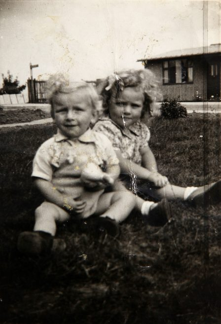 Two small children in the prefab garden. Bolsover, Derbyshire