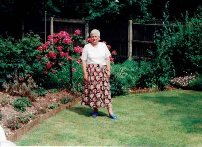 Debra Baker in her prefab garden, 413 Wake Green Road, Moseley