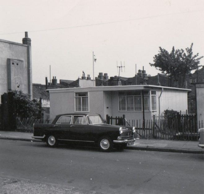 Dad's new Morris Oxford parked outside our prefab at no. 4 Tooke St. London, E14