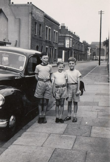 Harry, me and friend John, he lived in the victorian house next to the house with the patched wall....It's 1956 and we are ready for a day out to the hopfields then on to the seaside. Tooke Street, London E14