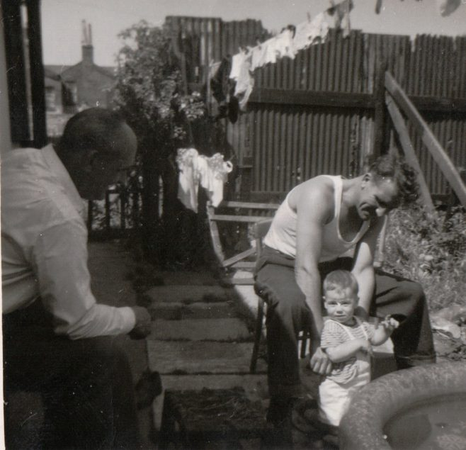 East side of our prefab, Andy, Uncle Dennis and my brother Tony about 1960. Tooke Street, London E14