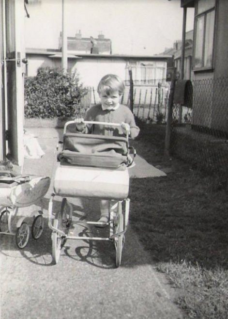 With her pram outside the prefab, Homerton, London E9