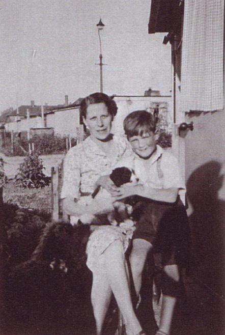 Jim and his mum, and dog. Excalibur Estate, London SE6