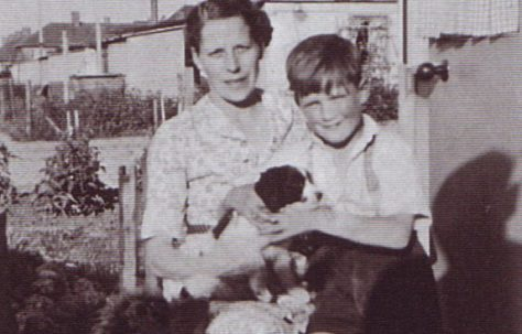 Jim and his mum, and dog. Excalibur Estate, London SE6