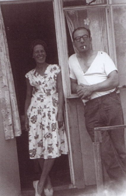 Jim's mum and dad in the doorway of their prefab. Excalibur Estate, London SE6