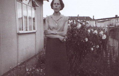 Jim's mum outside the prefab. Excalibur Estate, London SE6