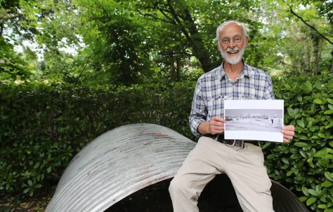 Portrait of John Green holding the BCF huts photo, Avoncroft Museum July 2016
