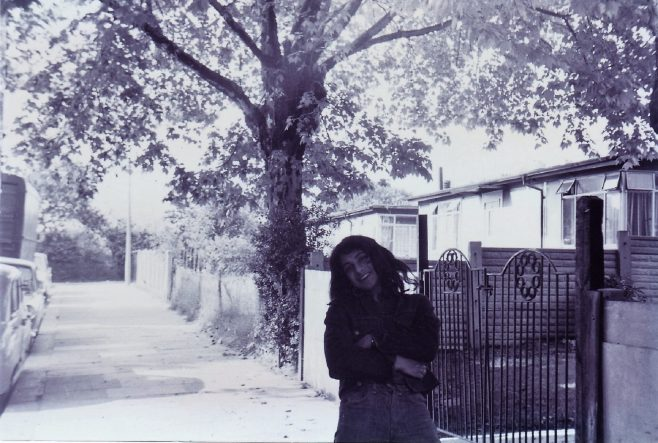 Jo outside the prefabs on St Helens Gardens, London NW10