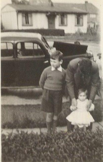Melanie and family outside the prefab. Lowden Croft, South Yardley, Birmingham