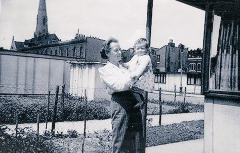 Mrs Rennie with baby. St Lawrence Road, Brixton