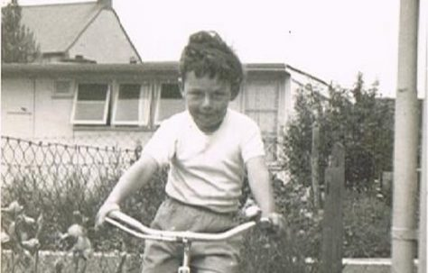 Bernard on his bike in the prefab garden. 60 Harewood Road, Coventry