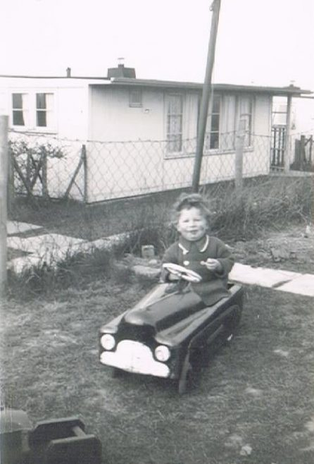 Bernard in his toy car, prefab garden. 60 Harewood Road, Coventry