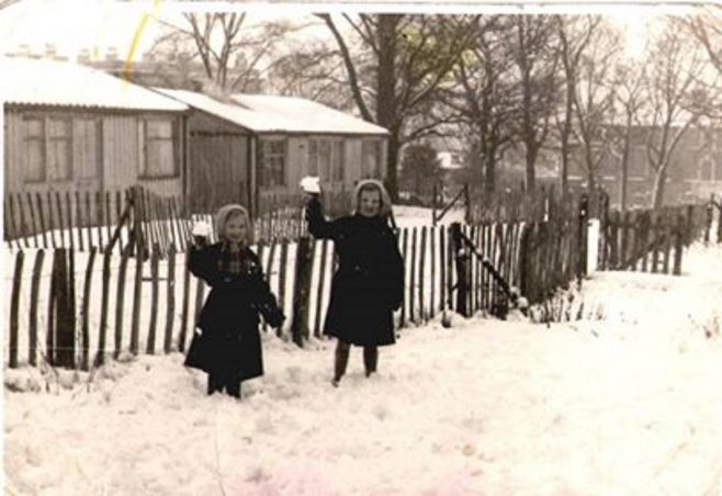 Brenda Anderson and Jeannette Anderson in the snow. Hollyhedge Bungalows, Blackheath SE3