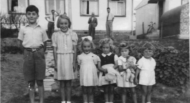 Bob and friends in front of the prefab. Barnfield Road, St Mary Cray