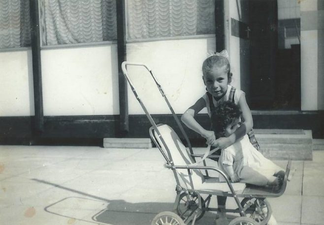 Dave's sister with her doll's pram. Essian Street, Stepney