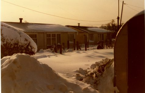 Arcon prefabs in the snow, Treberth estate, Newport