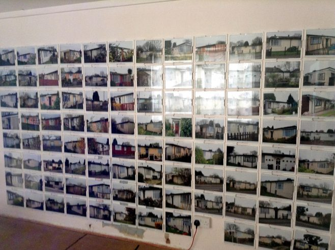 Wall of photos of prefabs on the Excalibur Estate, Prefab Museum. 15 April 2014.