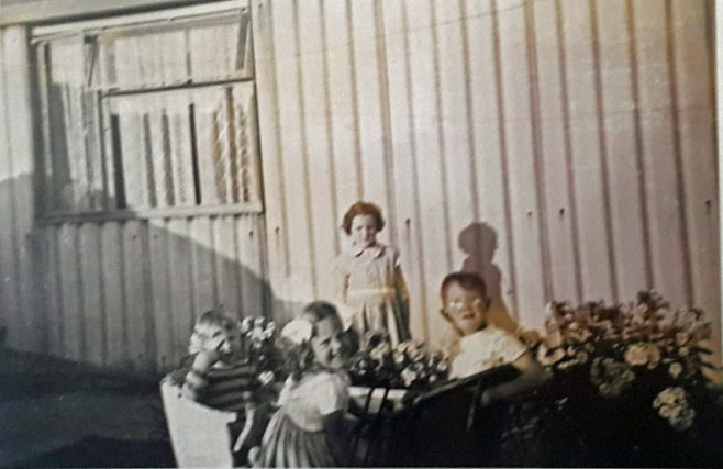 Lesley and her brother and cousins in the garden at Avelon Road. Romford.