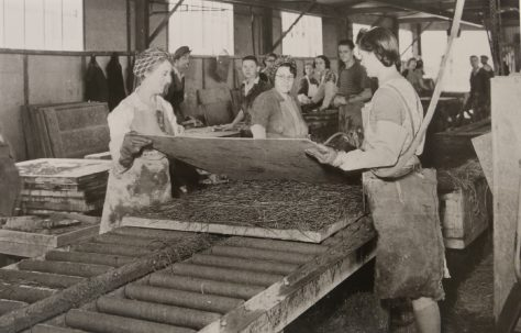 Factory workers assembling insulation for the prefabs
