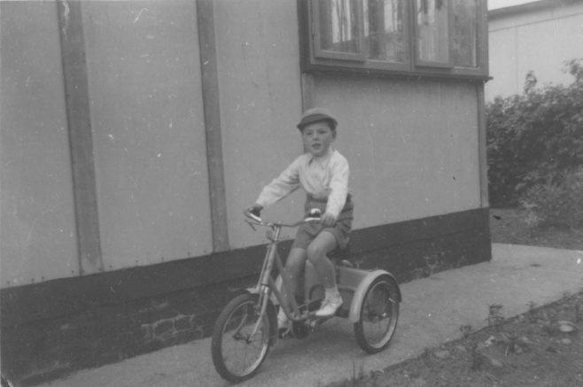 Robert on his bike outside the prefab. Kendal Road, London NW10