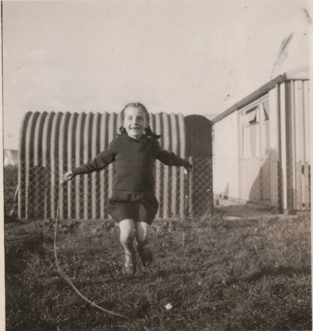 Anne skipping in the prefab back garden, St Andrews Drive, Lincoln