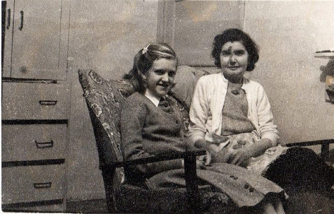 My mother Nellie Attwell & me, Brenda Attwell (now Ward) sitting on our little settee to the left of the fire place with the door into the hall behind us. Port Talbot Place, Fforestfach, Swansea