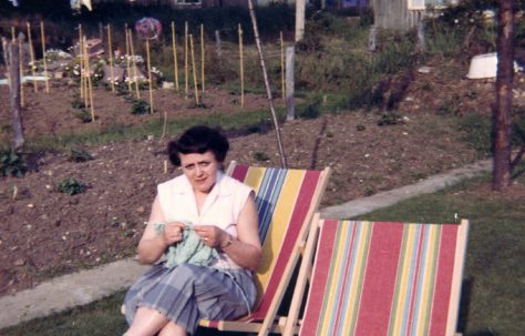 Elsie knitting in the prefab garden. Sixth Street, Pollards Hill