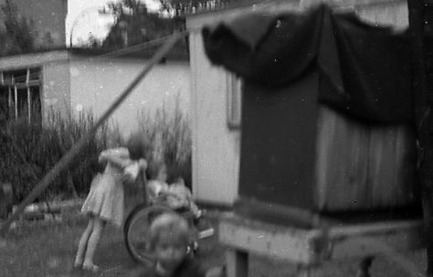 Children playing in the prefab garden. Sixth Street, Pollards Hill