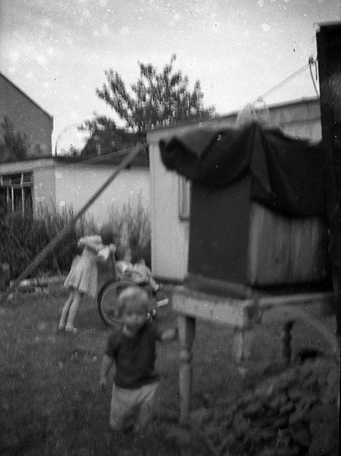 Children playing in the prefab garden. Sixth Street, Pollards Hill
