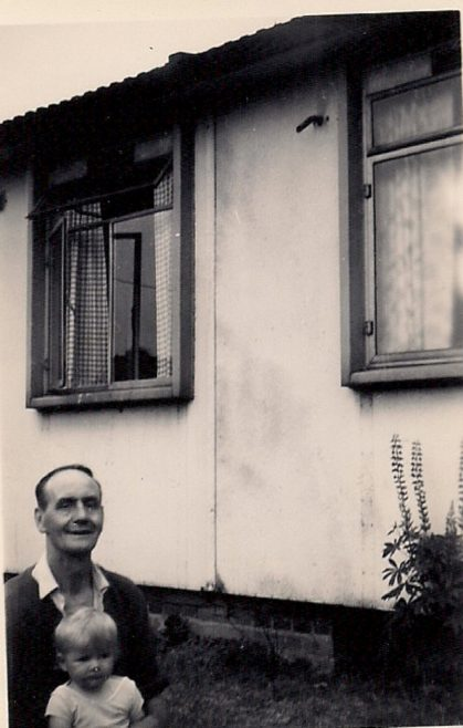 Martyn with his grandfather outside the prefab. Stapleford Road, Kings Norton