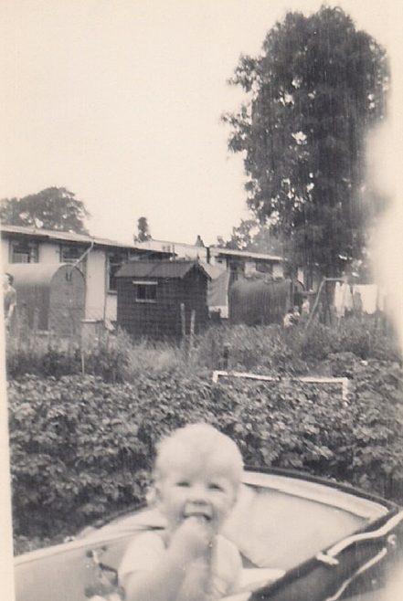 Martyn in his pram in the prefab garden. Stapleford Road, Kings Norton